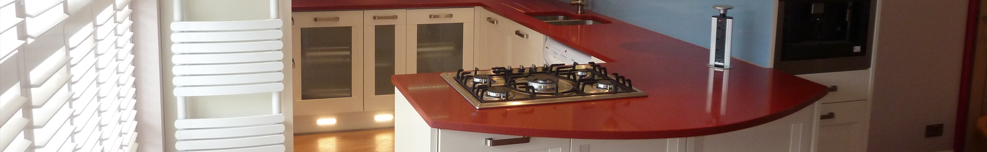 kitchen with red worktops